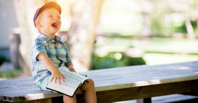 boy-bible-laughing
